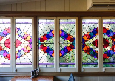 These stained glass windows at the Flying Nun Cafe in Samford were hand made.